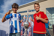 A young Brighton fan and Nottingham Forest fan with the Sky Bet Championship trophy outside the AMEX Stadium before the Sky Bet Championship match between Brighton and Hove Albion and Nottingham Forest at the American Express Community Stadium, Brighton and Hove, England on 7 August 2015.