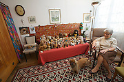 """Vienna, Karl-Marx-Hof. Doris Nasty, 82, lives here since 1930 when construction was finished, here with her Pekinese Wasti in the """"Bears Room""""."""