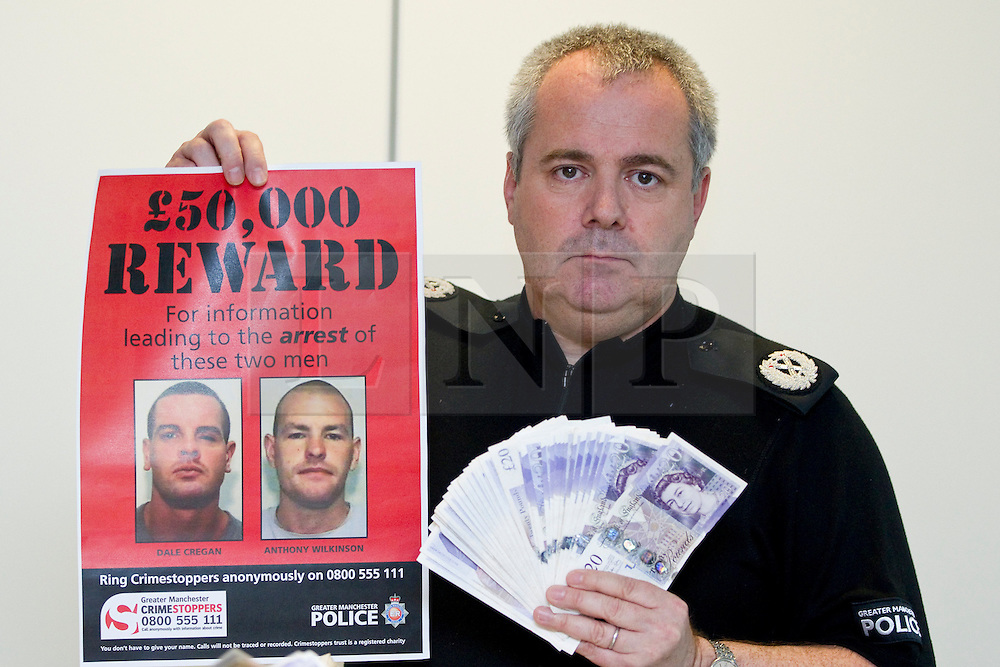 © Licensed to London News Pictures. 29/08/2012 . Manchester, UK . ACC Garry Shewan of Greater Manchester Police alongside a £50,000 cash reward on offer for anyone who can give information that'll lead to the arrest of Dale Cregan and Anthony Wilkinson . The two men are wanted in connection with the death of David Short . Photo credit : Joel Goodman/LNP
