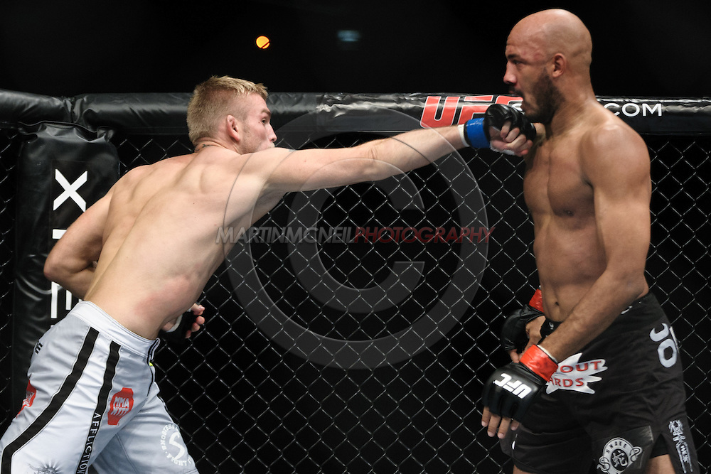 """LONDON, ENGLAND, OCTOBER 2010: Alexander Gustafsson (left) clips the chin of Cyrille Diabate during """"UFC 120: Bisping vs. Akiyama"""" inside the O2 Arena in Greenwich, London"""