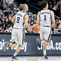 02 April 2017: San Antonio Spurs guard Tony Parker (9) brings the ball up court next to San Antonio Spurs guard Kyle Anderson (1) during the San Antonio Spurs 109-103 victory over the Utah Jazz, at the AT&T Center, San Antonio, Texas, USA.