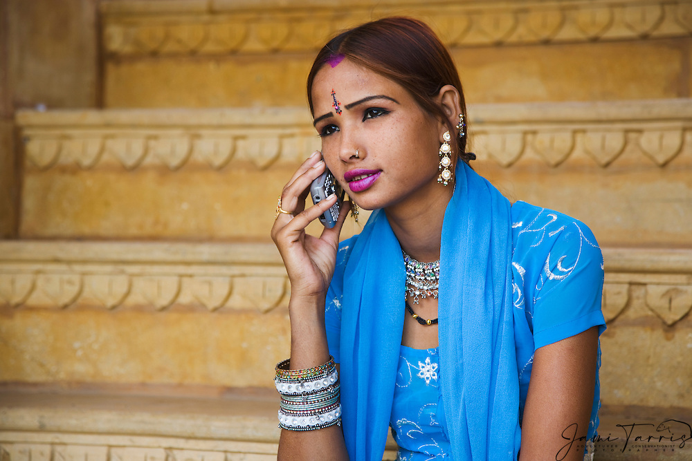 An Indian girl talking on a mobile phone,Jaisalmer,Rajasthan, India