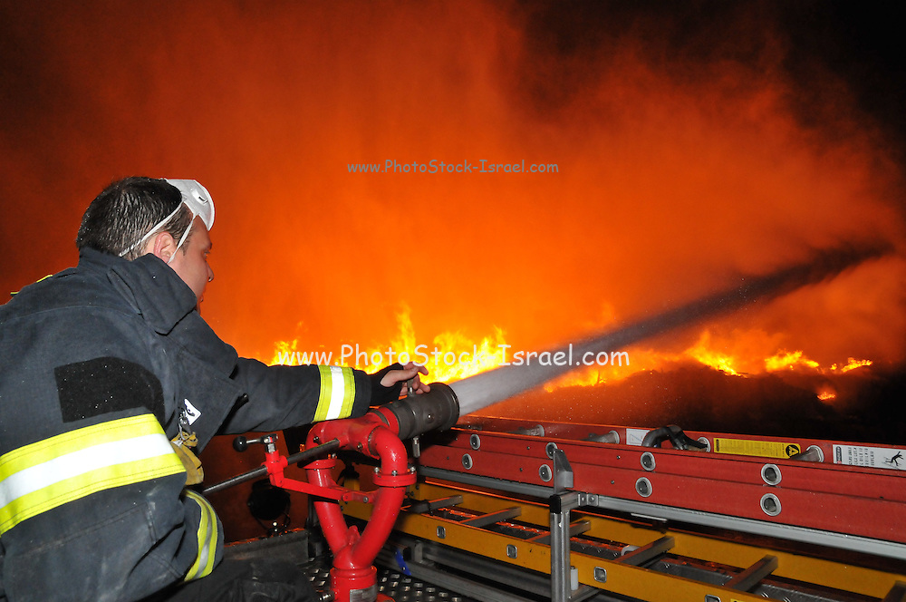 on June 12th 2014, Israeli firefighters fought a fire that broke out near the Haifa Oil Refinery in the Haifa Bay, Israel