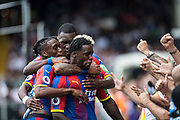 Jeffrey Schlupp (15) of Crystal Palace, celebrates after scoring goal during the Premier League match between Fulham and Crystal Palace at Craven Cottage, London, England on 11 August 2018.