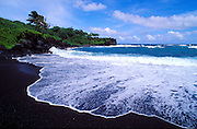 Black sand beach and surf at Waianapanapa State Park, Hana, Maui, Hawaii