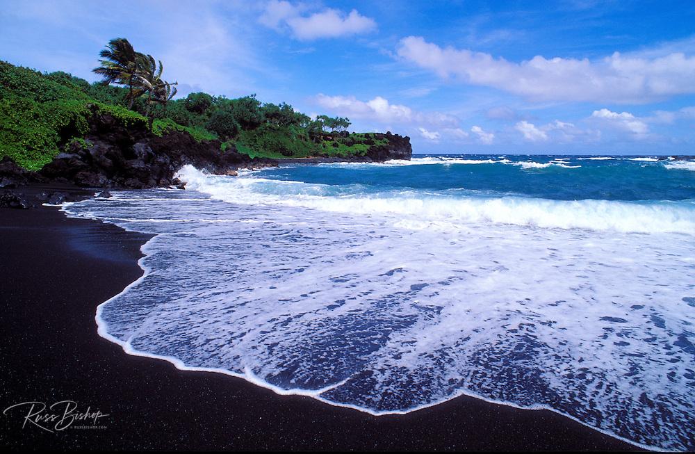 Black sand beach and surf at Waianapanapa State Park, Hana, Maui, Hawaii