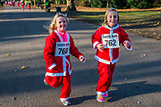 2000 Santas of all ages take part in the annual Santa Run in Battersea Park to support Noah's Ark Children's Hospice.