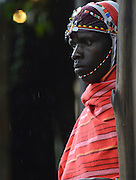 Kenya, Local man in traditional dress awaiting tourists