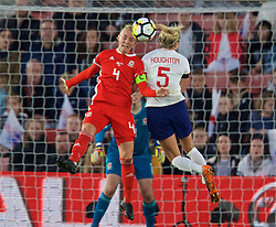SOUTHAMPTON, ENGLAND - Friday, April 6, 2018: Wales' captain Sophie Ingle and England's captain Steph Houghton during the FIFA Women's World Cup 2019 Qualifying Round Group 1 match between England and Wales at St. Mary's Stadium. (Pic by David Rawcliffe/Propaganda)
