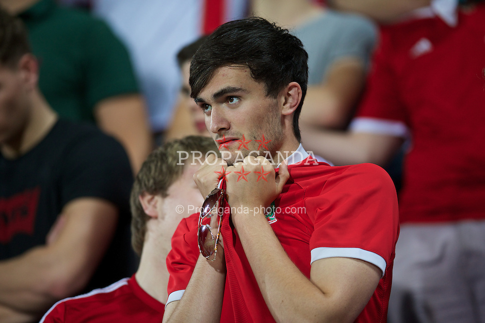 ANDORRA LA VELLA, ANDORRA - Tuesday, September 9, 2014: A Wales supporter looks pensive as he watches his side against Andorra during the opening UEFA Euro 2016 qualifying match at the Camp d'Esports del M.I. Consell General. (Pic by David Rawcliffe/Propaganda)