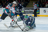 KELOWNA, CANADA -FEBRUARY 10:Justin Kirkland #23 of the Kelowna Rockets digs for the puck as Danny Mumaugh #1 of the Seattle Thunderbirds makes the save in the third period on February 10, 2014 at Prospera Place in Kelowna, British Columbia, Canada.   (Photo by Marissa Baecker/Getty Images)  *** Local Caption *** Justin Kirkland; Danny Mumaugh;
