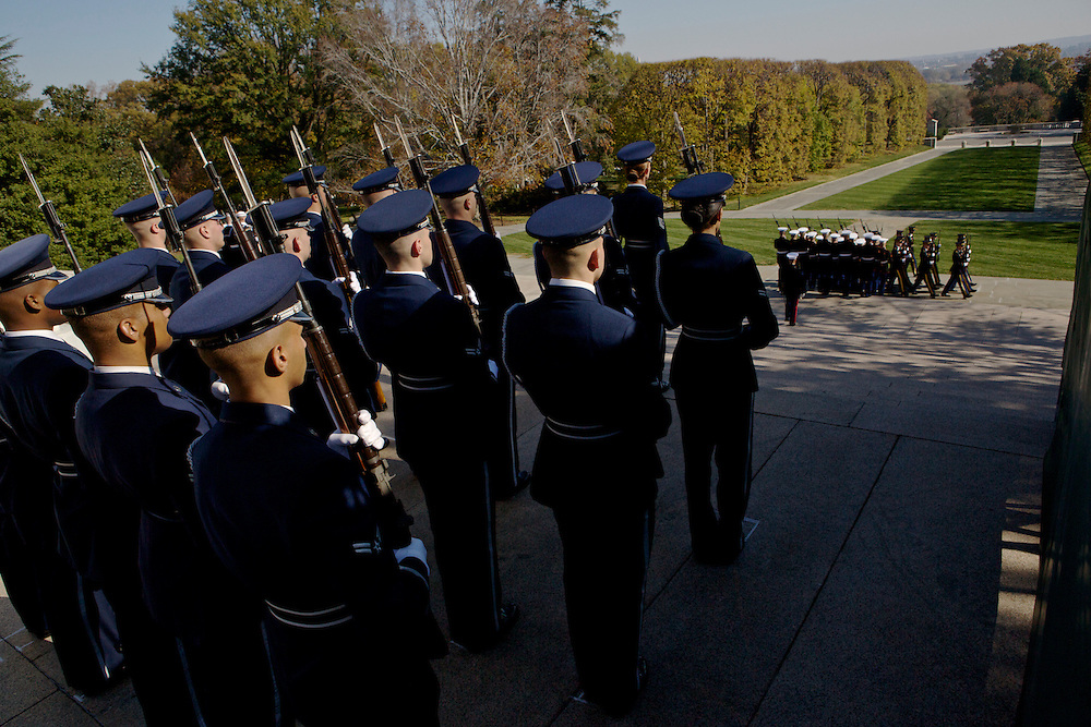ARLINGTON, VA - NOVEMBER 11: Honor Guards from each branch of the military walk in formation away from the Tomb of the Unknowns on Veteran's Day at Arlington National Cemetery on November 11, 2012 in Arlington, Virginia.