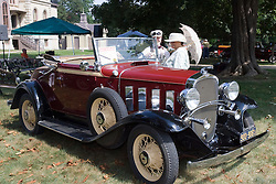 06 Aug 2011:  A couple dressed in period dress admire a 1932 Chevrolet Cabrolet owned by John and Jeanette Tornquist at the 15th Annual McLean County Car Association Antique Car show at David Davis Mansion, Bloomington Illinois