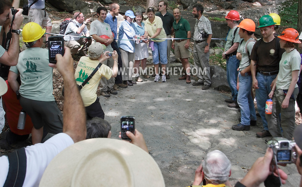 Bear Mountain, New York - People take photographs at the ribbon cutting for a newly-rebuilt section of the Appalachian Trail during National Trails Day at Bear Mountain on June 5, 2010. A ceremony and hike celebrated the reconstruction of this original section of the Appalachian Trail. More than 800 volunteers, along with professionals, built 800 hand-hewn rock steps and a broad, gently sloping trail bed atop nearly a mile of rock wall built to sustain the traffic of more than 500,000 hikers annually.