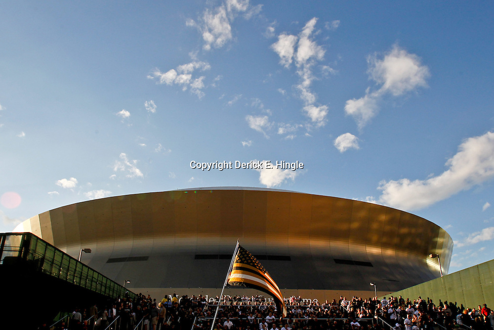 January 7, 2012; New Orleans, LA, USA; A New Orleans Saints themed flag is seen being waved by a fan known as Saint Fett the bounty hunter of New Orleans outside in Champions Square before the 2011 NFC wild card playoff game against the Detroit Lions at the Mercedes-Benz Superdome. Mandatory Credit: Derick E. Hingle-US PRESSWIRE
