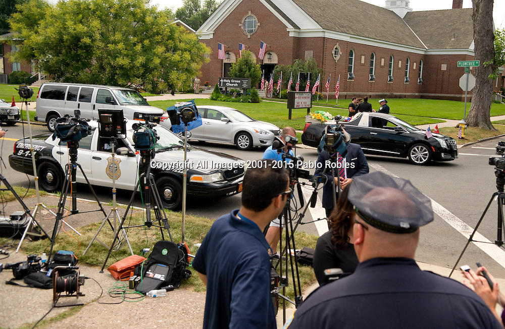 Media gathers during the funeral service for Marine Gunnery Sgt. Thomas Sullivan in Springfield, Mass., Monday, July 27, 2015. Sullivan is one of the five service men killed in the July 16 shooting in Chattanooga, TN.