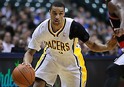 March 13, 2012; Indianapolis, IN, USA; Indiana Pacers shooting guard George Hill (3) brings the ball up court against the Portland Trail Blazers at Bankers Life Fieldhouse. Indiana defeated Portland 92-75. Mandatory credit: Michael Hickey-US PRESSWIRE