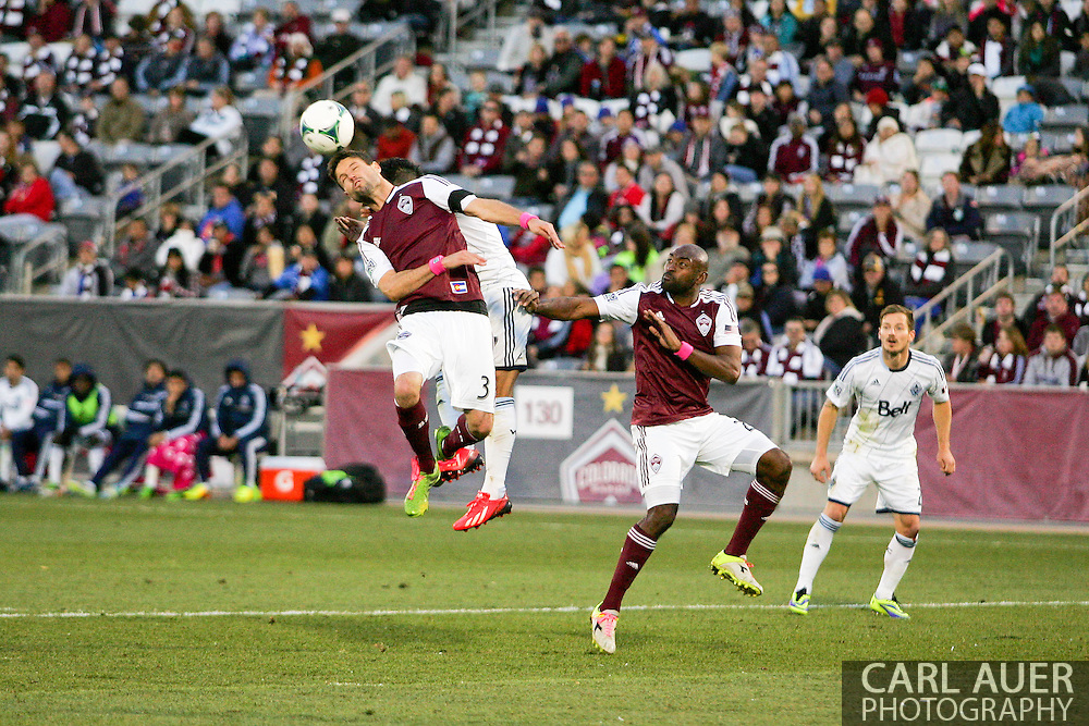 October 19th, 2013:  Colorado Rapids defender Drew Moor (3) heads the ball out of the box in the second half of the MLS Soccer Match between the Vancouver Whitecaps FC and the Colorado Rapids at Dick's Sporting Goods Park in Commerce City, Colorado