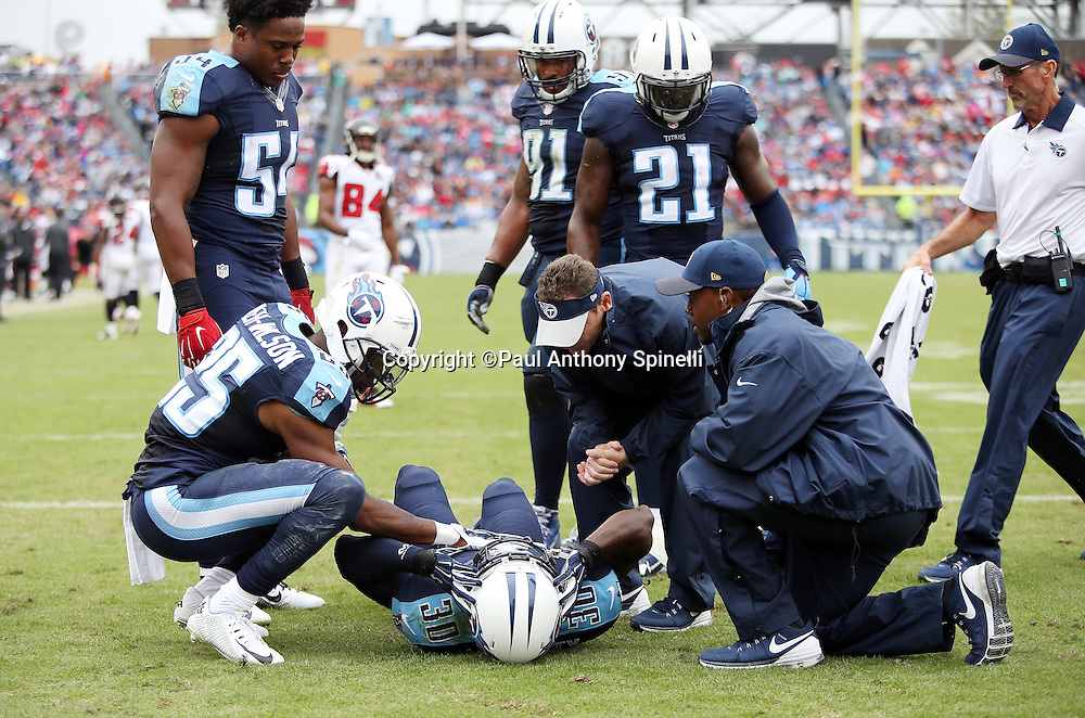 Tennessee Titans cornerback Jason McCourty (30) gets medical attention as he gets shaken up on a second quarter play during the 2015 week 7 regular season NFL football game against the Atlanta Falcons on Sunday, Oct. 25, 2015 in Nashville, Tenn. The Falcons won the game 10-7. (©Paul Anthony Spinelli)