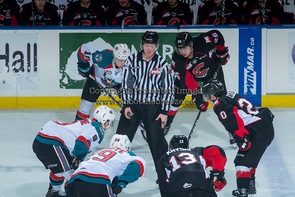 KELOWNA, CANADA - MARCH 14: Ted Brennan #10, Marek Skvrne #9 and Nolan Foote #29 of the Kelowna Rockets line up against Max Kryski #13, Ilijah Colina #20 and Reid Perepeluk #26 of the Prince George Cougars as linesman Cody Wanner stands at the face off to drop the puck on March 14, 2018 at Prospera Place in Kelowna, British Columbia, Canada.  (Photo by Marissa Baecker/Shoot the Breeze)  *** Local Caption ***