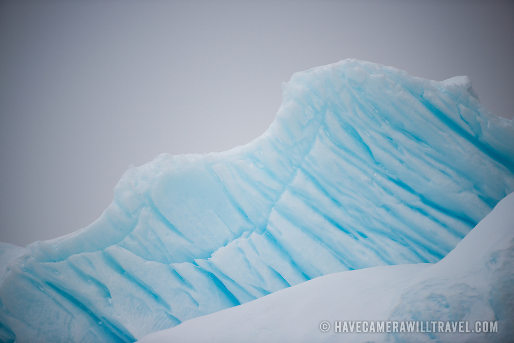 Deep channels carved into an iceberg from compressed air bubbles escaping to the surface of a glacier in Curtis Bay on the Antarctic Peninsula.