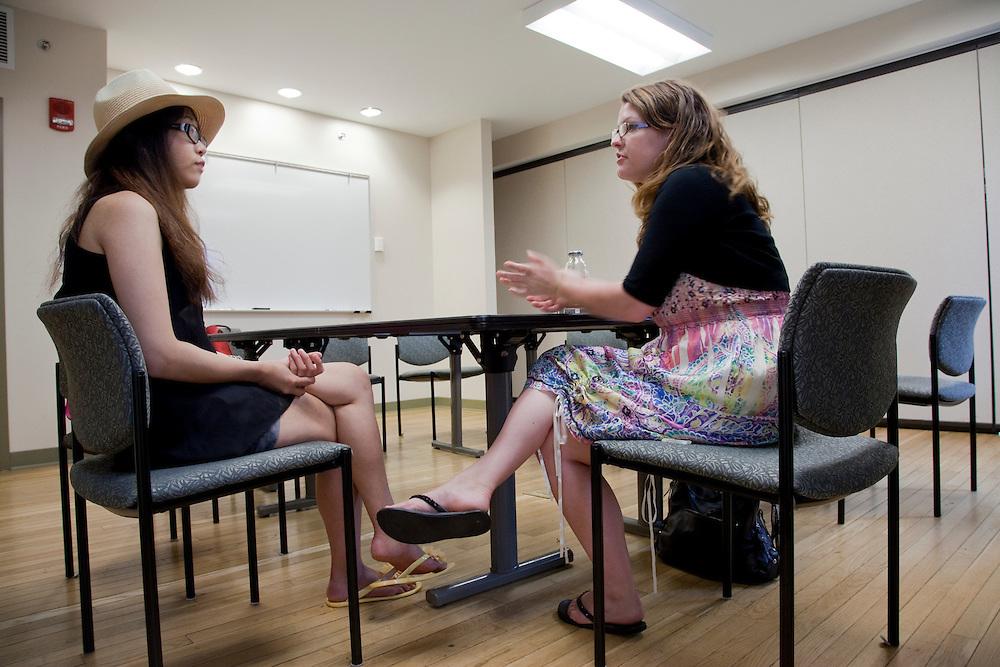 Kara Kauffman talks to Xi Mao during a walk in advising session at the Walter International Education Center