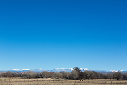 ranch in New Mexico overlooking snow covered mountains