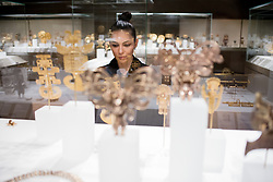 Teresita Fernández photographed in AAOA at The Metropolitan Museum of Art for Artist Project 2015 episode. Focusing on Precolumbian gold works. © 2015 MMA, photographed by Jackie Neale