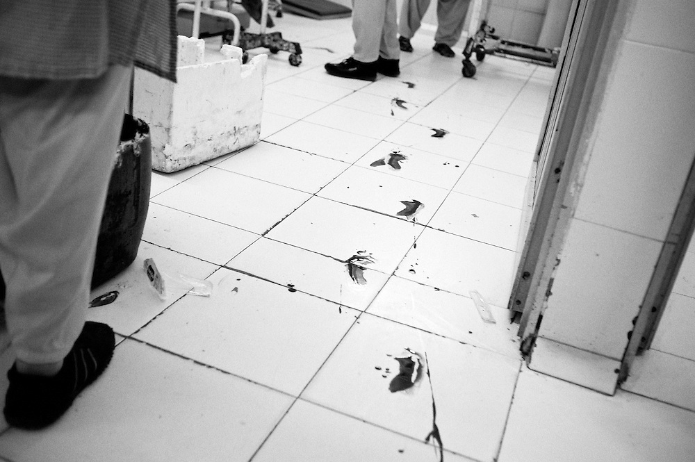 A womans bloody footsteps on the floor. Bleeding heavily while she walked from the bed to the delivery table and in need of a blood transfusion. Most women are anemic with a very low count of hemogloben making their delivery more dangerous. Karachi, Pakistan, 2010