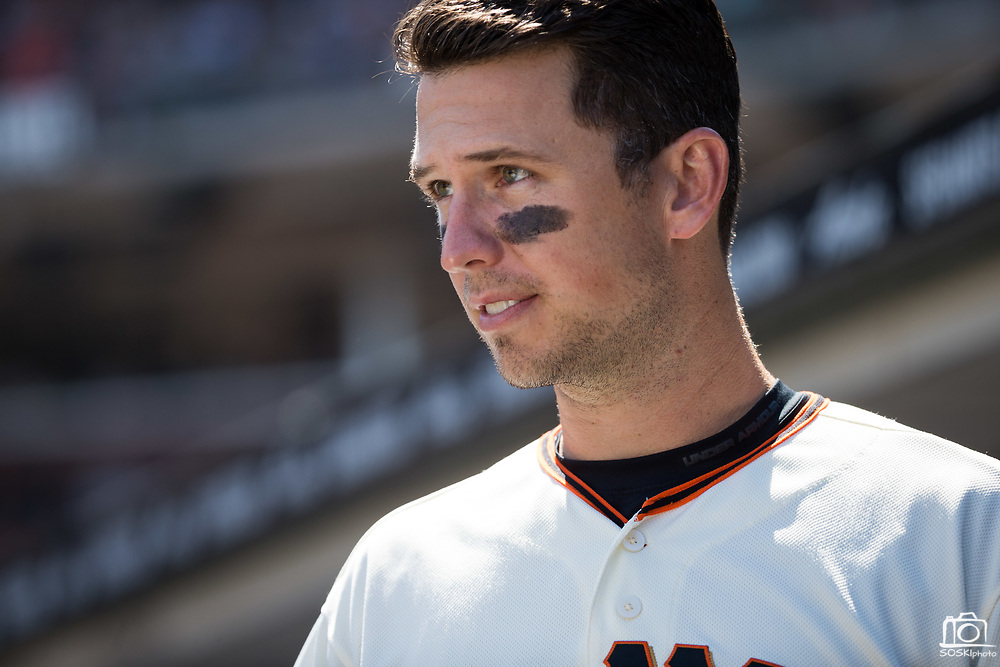 San Francisco Giants first baseman Buster Posey (28) hangs out in the dugout during a MLB game against the Arizona Diamondbacks at AT&T Park in San Francisco, California, on August 6, 2017. (Stan Olszewski/Special to S.F. Examiner)