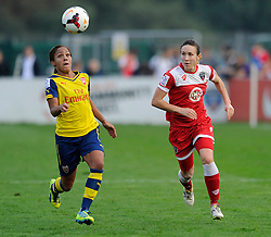 Arsenal Ladies Alex Scott is chased down by Bristol Academy Women's Corinne Yorston - Photo mandatory by-line: Dougie Allward/JMP - Mobile: 07966 386802 - 20/09/2014 - SPORT - FOOTBALL - Bristol - SGS Wise Campus - BAWFC v Arsenal Ladies - FA Womens Super League