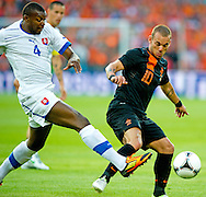 In action for    Wesley Sneijder against Karim Guede    (l) The Netherlands versus    Slovakia during friendly soccer match between Netherlands vs Slovakia in Rotterdam on May 30, 2012. AFP PHOTO/ ROBIN UTRECHT