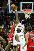 Apr 27, 2010; Cleveland, OH, USA; Cleveland Cavaliers forward LeBron James (23) blocks a shot by Chicago Bulls forward Hakim Warrick (21) during the second period in game five in the first round of the 2010 NBA playoffs at Quicken Loans Arena.  Mandatory Credit: Jason Miller-US PRESSWIRE