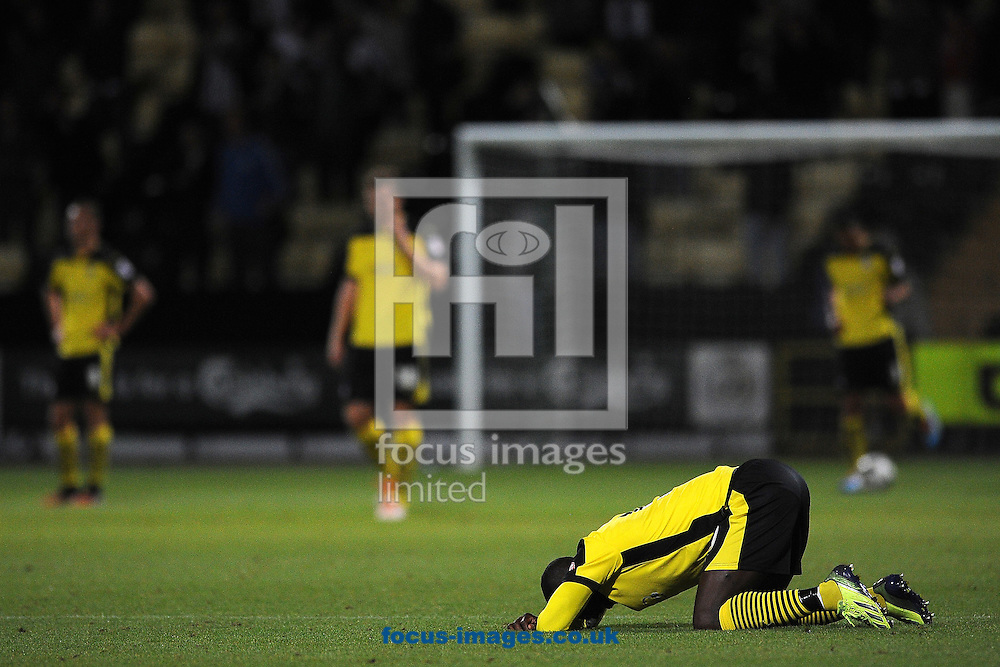 Jabo Ibehre of Colchester United goes to the floor after Liam Noble of Notts County scores a goal to make the scoreline 2-1 during the Sky Bet League 1 match at Meadow Lane, Nottingham<br /> Picture by Richard Blaxall/Focus Images Ltd +44 7853 364624<br /> 19/08/2014