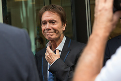© Licensed to London News Pictures. 18/07/2018. London, UK. SIR CLIFF RICHARD  leaves the Rolls Building of the High Court in London after winning his claim for damages against the BBC for loss of earnings. The 77-year-old singer sued the corporation after his home in Sunningdale, Berkshire was raided following allegations of sexual assault made to Metropolitan Police. Photo credit: Rob Pinney/LNP