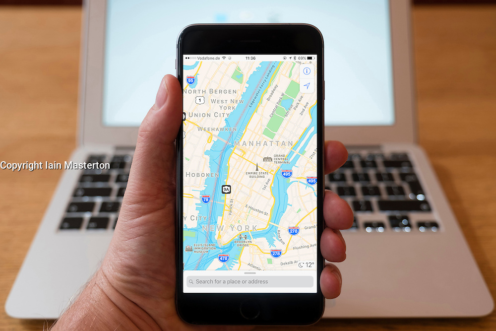 Using iPhone smartphone to display Apple Maps view of central New York city