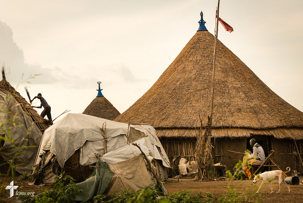 A man works on a home Wednesday, Sept. 23, 2015, at the Leitchour Refugee Camp outside Gambela, Ethiopia. LCMS Communications/Erik M. Lunsford