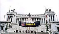 Rome  March 22 2003  .Greenpeace activists have drawn up a banner of 20 meters on the Altare della Patria monument devoted to the soldiers killed in world wars, tracks the face of Silvio Berlusconi with a military helmet and the words: 'A commitment War'