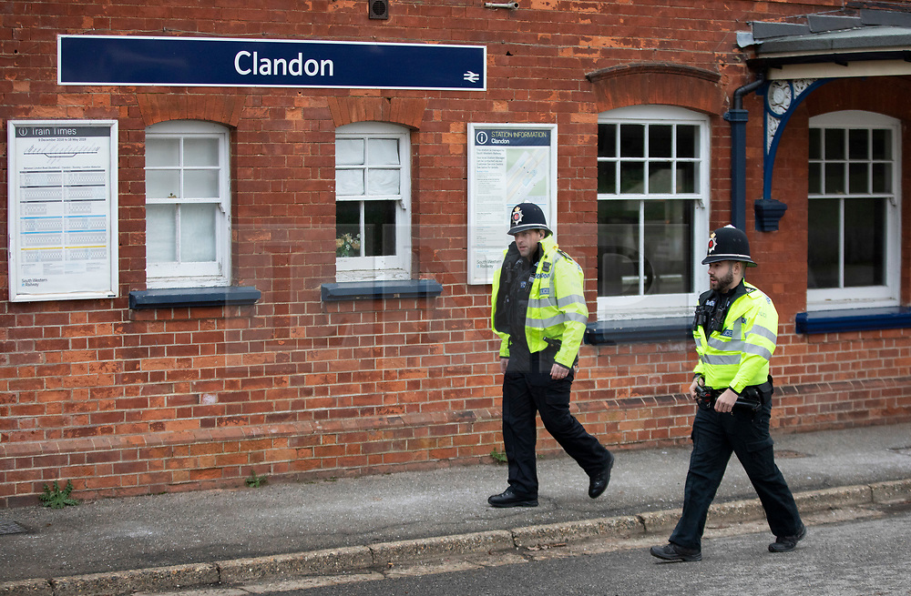 © Licensed to London News Pictures. 05/01/2019. Clandon, UK. Police officers patrol West Clandon station in Surrey - where a man left the Waterloo bound train after a passenger was stabbed to death yesterday. A murder investigation has been launched after the man was attacked while on board the 12. 58pm train service travelling between Guildford and London Waterloo. A man and a woman have been detained by police in Farnham in connection with the murder. Photo credit: Peter Macdiarmid/LNP
