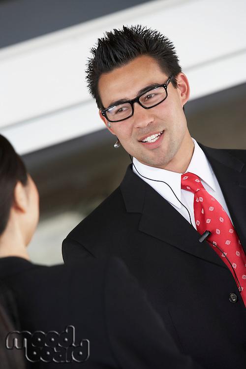 Businessman using hands free kit half-length