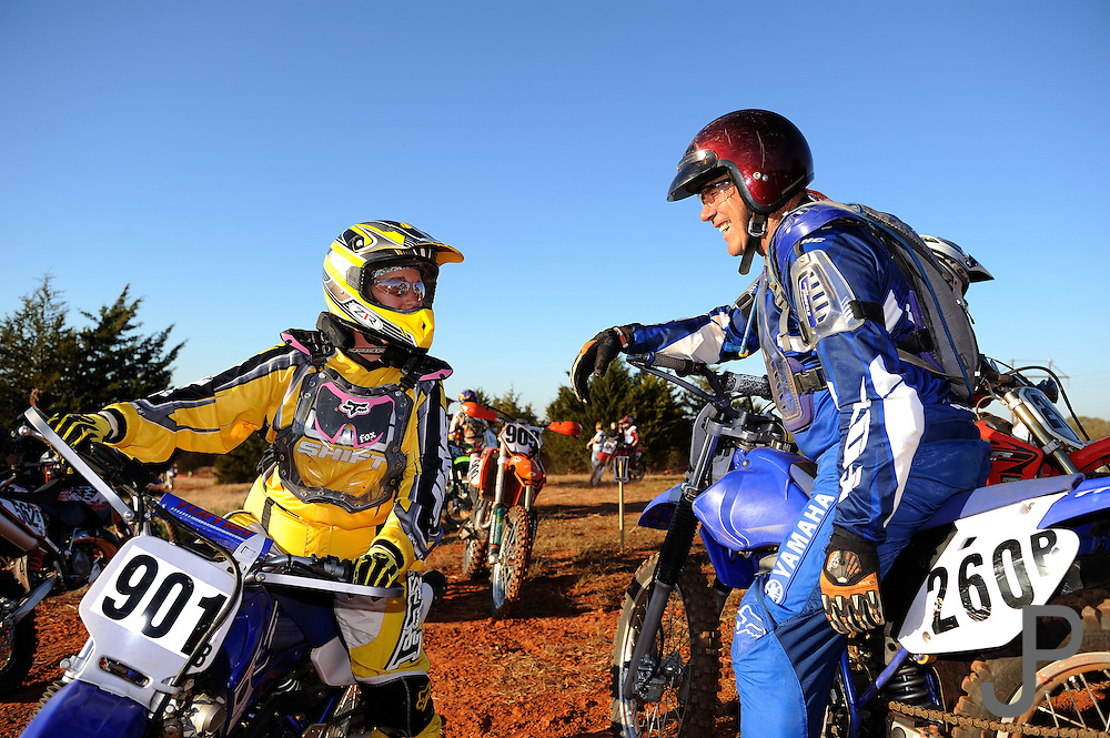 68 year old Glen Sinclair talking to his daughter at OCCRA cross country race in Wellston, OK