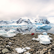 A high resolution panorama of a kayakers going ashore on the beach at Cuverville Island on the Antarctic Peninsula.