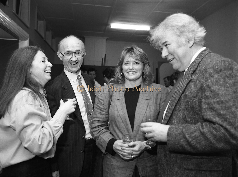 """These Obstreperous Lassies"" Book Launch.  (R93)..1988..15.12.1988..12.15.1988..15th December 1988..A book which chronicles an important aspect of Irish social history was launched in Larkin Hall. ""These Obstreperous Lassies"" written and researched by Mary Jones, details the seventy three years of the Irish Women Workers Union and of the women who were involved in the union..With Countess Markievicz as its first president, The Union began the fight for equal pay and fair treatment under the leadership of women like helen Chenevix, Louise Bennett and Helena Molloy. They fought for the rights of vulnerable workers such as Laundresses,print workers,box makers,nurses and dressmakers..The Author, Mary Jones, is a full time researcher specialising in Women and Work...Picture shows the Author Mary Jones (L) chatting with Michael Gill, Managing Director, Gill and McMillan (The Publishers), Marie Heaney and Seamus Heany at the launch of the book."