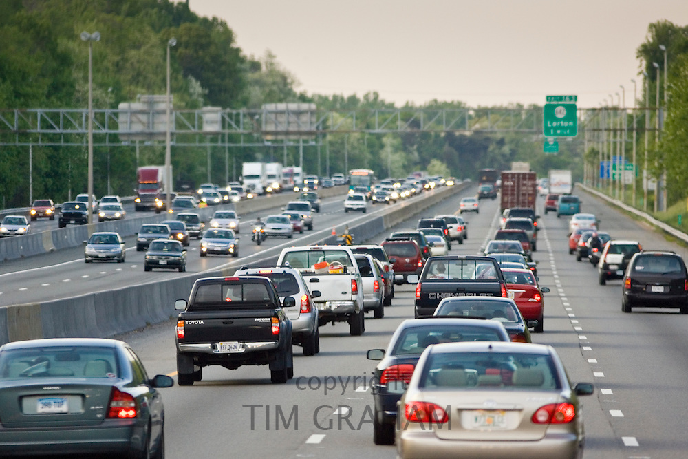 Heavy weight of traffic travelling on freeway lanes, outskirts of Washington DC, USA