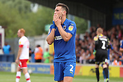 AFC Wimbledon defender Luke O'Neill (2) with hands on his mouth during the EFL Sky Bet League 1 match between AFC Wimbledon and Rotherham United at the Cherry Red Records Stadium, Kingston, England on 3 August 2019.