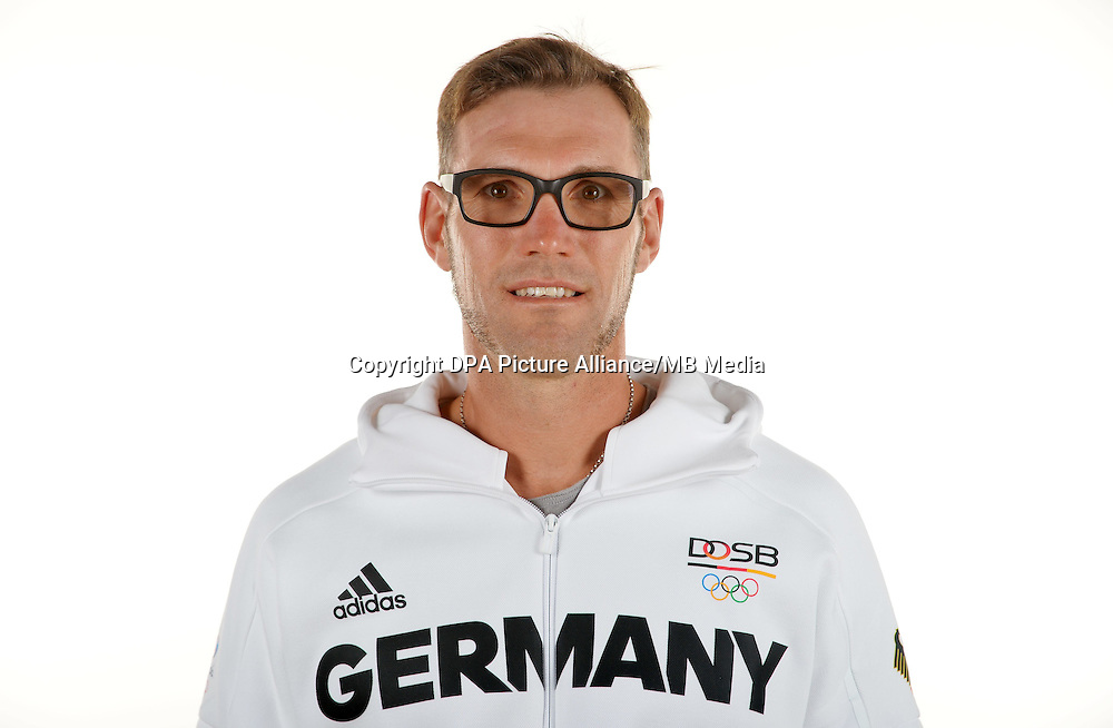 Marcel Hacker poses at a photocall during the preparations for the Olympic Games in Rio at the Emmich Cambrai Barracks in Hanover, Germany. July 08, 2016. Photo credit: Frank May/ picture alliance. | usage worldwide