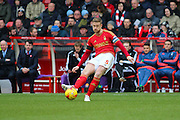 Nottingham Forest defender Matt Mills puts in a long-ball cross during the Sky Bet Championship match between Nottingham Forest and Huddersfield Town at the City Ground, Nottingham, England on 13 February 2016. Photo by Aaron  Lupton.