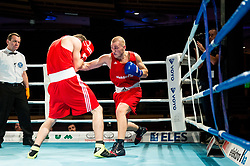 Denis Lazar of Slovenia (BLUE) fights against Umar Dzambekov of Austria (RED) in Elite 81 kg Category<br />  during Dejan Zavec Boxing Gala event in Sentilj, on September 30, 2017 in Mond, Casino &amp; Hotel, Sentilj, Slovenia. Photo by Vid Ponikvar / Sportida