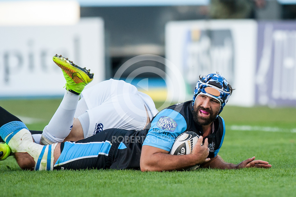 Glasgow Warriors Number 8 Josh Strauss (c) scores a try. Action from the Pro12 opening round match between Glasgow Warriors and Leinster at Scotstoun in Glasgow, 6 September 2014. The match was a re-run of last season's Pro 12 Final. (c) Paul J Roberts / Sportpix.org.uk