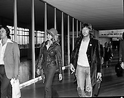 "Arrivals of Eric Clapton and Judy Geeson at DAP..1975..13.09.1975..09.13.1975..13th September 1975..Today saw the arrivals of musician Eric Clapton and actress Judy Geeson at Dublin Airport. They are in Ireland to take part in ""Circasia 75"" at Straffan House,Co Kildare..Image shows the arrival of Eric Clapton at the airport ,he was accompanied by Patti Harrison as they strolled from the aircraft."
